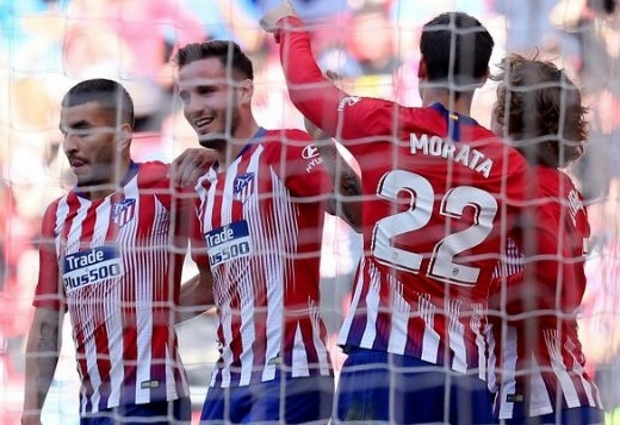Atletico Madrid 1 -0 Real Valladolid: Joaquin own goal keeps Barcelona waiting