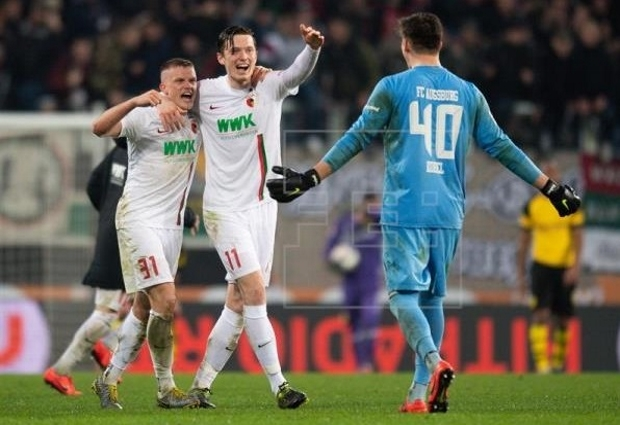 Augsburg 2 -1 Borussia Dortmund: Bavarians boost neighbours Bayern in Bundesliga title race