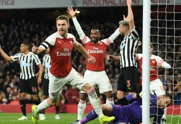 Arsenal 2 -0 Newcastle United: Aaron Ramsey and Alexandre Lacazette send Gunners third