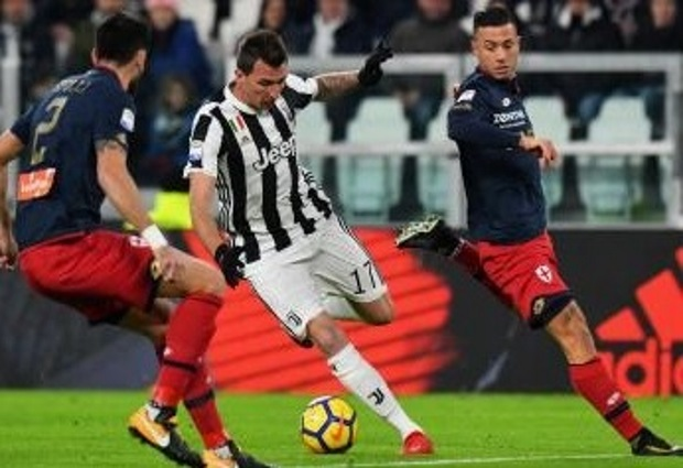Juventus 1 -0 Genoa: Douglas Costa saves below par hosts as they close the gap on Serie A leaders Napoli