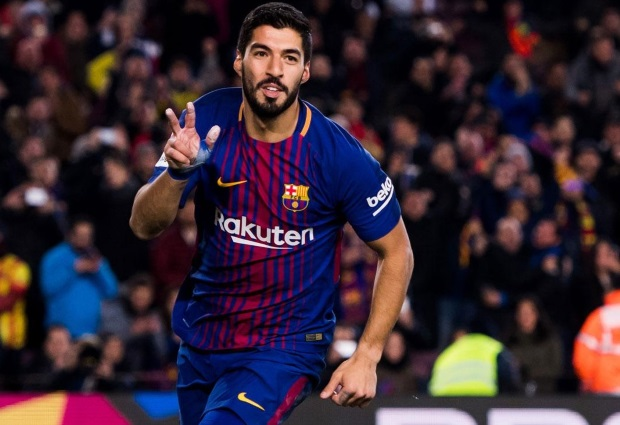 Barcelona 1 -0 Valencia: Luis Suarez heads in only goal after Lionel Messi magic in Copa del Rey clash