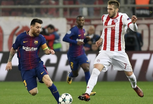 Olympiacos 0- 0 Barcelona: Luis Suarez left to rue missed opportunities while Lionel Messi is hounded by pitch invaders as the points are shared in Athens