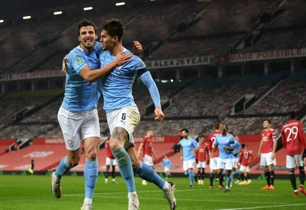 Manchester United 0-2 Manchester City: Stones ends goal drought as holders reach another final