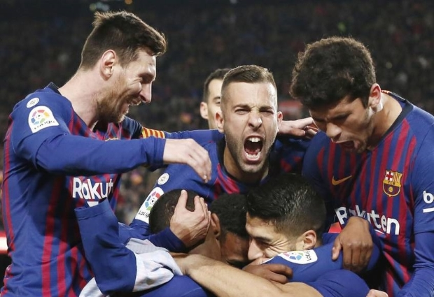Barcelona 2 -0 Atletico Madrid: Luis Suarez and Lionel Messi strike late to all but secure the title