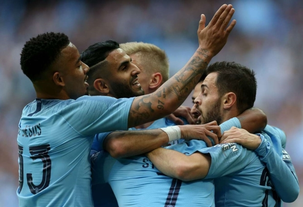 Manchester City 6 -0 Watford: Sterling hat-trick helps secure unprecedented domestic treble